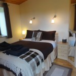 Brown bedroom - Luxury hot tub holiday accommodation in Wales